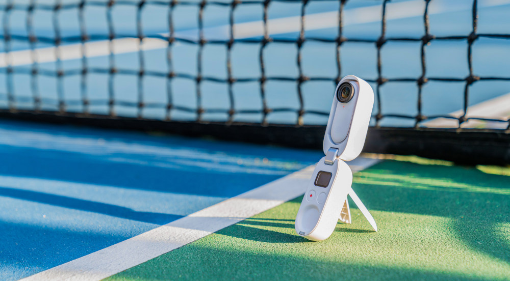 Insta360 GO 2 Charge Case on Tennis Court