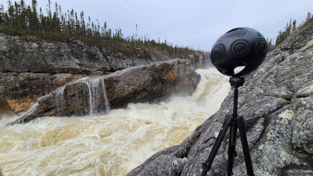 Insta360 Titan on the rocks next to a rushing river. Shooting for the immersive virtual reality experience.