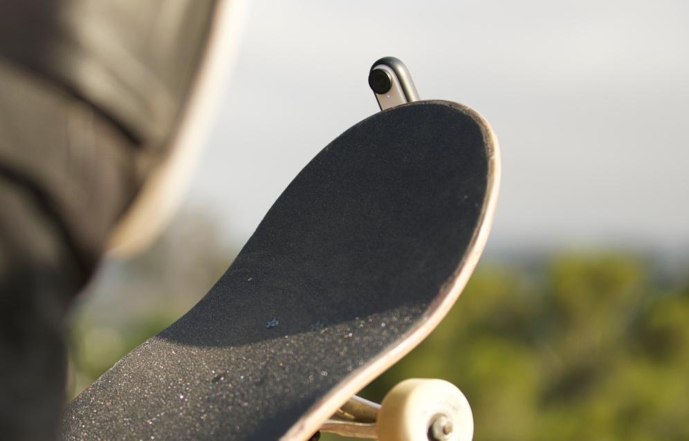 Insta360 GO 2 mounted underneath a skateboard.